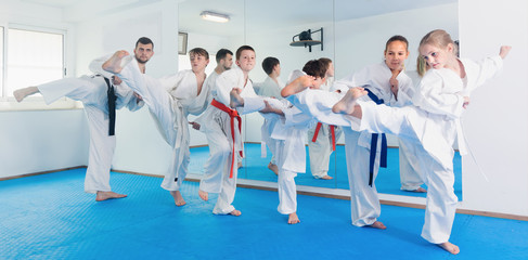 Children practicing new moves during karate class