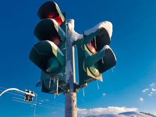 traffic lights snow icered  blue sky