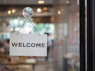 Welcome sign outside a restaurant, store, office or other