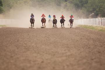 Jockeys during horse races on his horses.