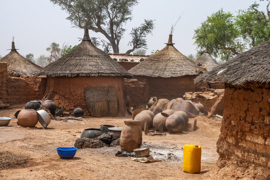 Courtyard of traditional mosi home with huts in a village of Northern Burkina Faso, West Africa.