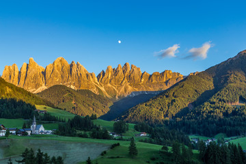 Iconic mountain landscape in Dolomites  region, Santa Maddalena in Funes valley, Italy.