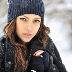 Beautiful woman face in winter - close up