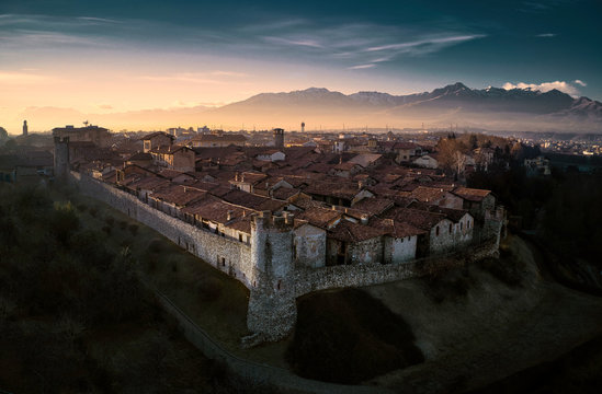 Aerial view of Ricetto of Candelo, Biella, Italy, at golden hour beautiful landscape