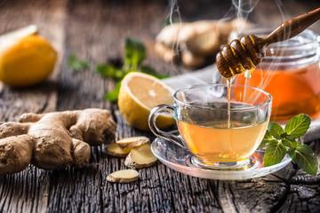 Ginger tea honey lemon and mint leaves on wooden table