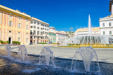 Piazza Raffaele De Ferrari square with fountain, Palazzo Ducale Doge's Palace and Teatro Carlo Felice theatre building in historical centre of old city Genoa (Genova) with blue sky, Liguria, Italy