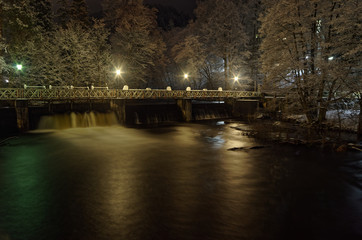Pedestrian bridge over small dam by night, Bad Lauterberg, Germany