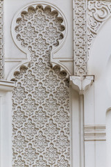 The wall of the mosque with traditional in Islam geometric patterns in architecture, the background