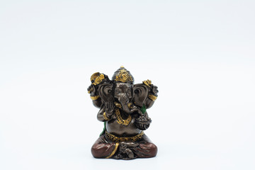 An ornate statue of ganesh / ganesha statue on an isolated white background