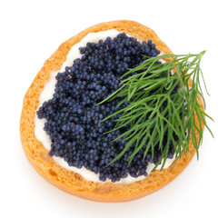 Canapes with black sturgeon caviar and  dill. Isolated on the white background.