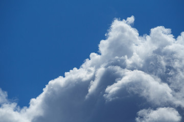 Close up view of a fluffy clouds in the blue sky
