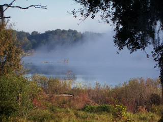 Heavy fog lays on the lake early in the moning