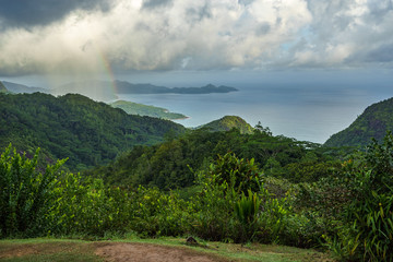 rainbow and rain over the jungle and mountains of mahé, seychelles 3