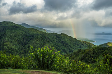 rainbow and rain over the jungle and mountains of mahé, seychelles 11