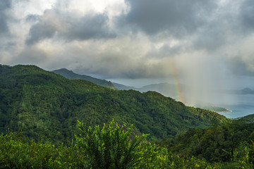 rainbow and rain over the jungle and mountains of mahé, seychelles 12