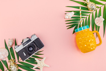 Tropical palm leaves vacations pink background