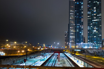 Chicago Museum Campus train Station in winter evening with bright public lights and luxury apartment tower in the background