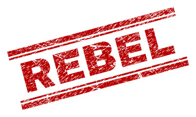 REBEL seal print with distress texture. Red vector rubber print of REBEL text with grunge texture. Text title is placed between double parallel lines. Fototapete