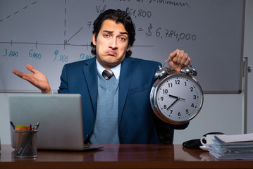 Financial specialist working late in the office