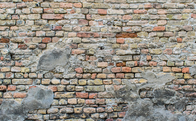 Old grunge ruined brick wall background texture