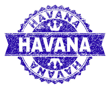 HAVANA rosette stamp seal watermark with grunge style. Designed with round rosette, ribbon and small crowns. Blue vector rubber print of HAVANA title with grunge style.