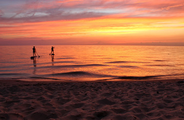 Paddle Boarders in Afterglow