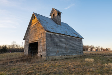 Old wooden barn at sunset.  LaSalle County, Illinois, USA