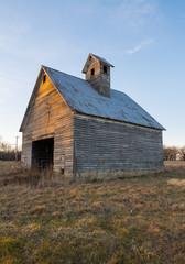 Old wooden barn at sunset.  LaSalle County, Illinois, USA