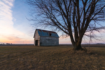 Old rustic barn as the sun sets.  Ogle County, Illinois, USA