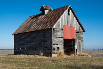 Old wooden barn in the rural open farmland.  Illinois, USA