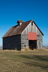 Old wooden barn in the rural open farmland.  Illinois, USA