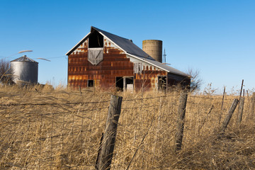 Old rustic barn in the rural Midwest on a windy Winter's day.  Marshall County, Illinois, USA