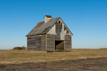 Old wooden barns in the open farmland.  LaSalle County, Illinois, USA