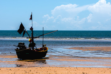 Fishing boat floating on peaceful sea waiting time to go fsihing