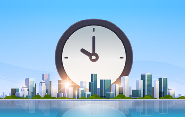 clock icon time management deadline business timing concept over big modern city building skyscraper cityscape skyline flat horizontal