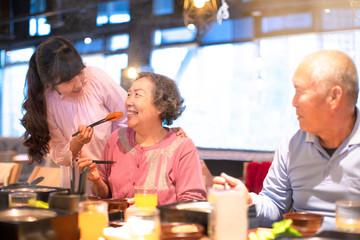 happy asian family having dinner