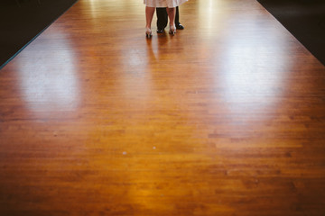 Fototapeta two people dancing on wooden floor