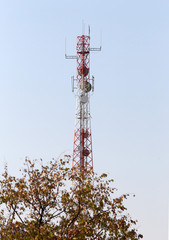 Cell phone tower or mobile cell site with blue sky background