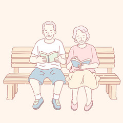 Middle aged couple reading books