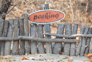 Parking sign on a wooden fence