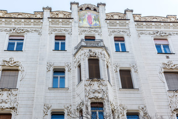 Old historic three-storey apartment house. Beautiful architectural elements, patterns, ornaments and tile painting of building on Liberty Square, Budapest, Hungary