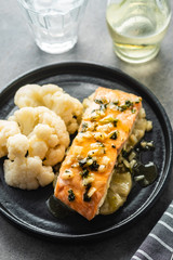 Solomon fillet with pineapple and cauliflower. Fish with vegetables.