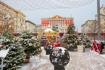 Moscow, Russia, New Year at the city hall. Christmas trees, carousel, light garlands - all for the new year holiday.