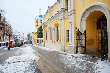 Moscow, Russia, the Church of saints Cosmas and Damian on Christmas holidays. In Stoleshnikov lane the Church kindly opened the gate for its parishioners.