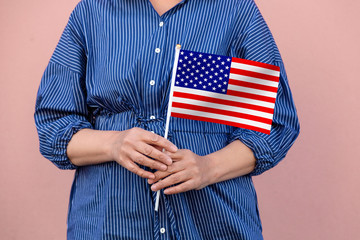 USA flag. Close up of hands holding American flag.