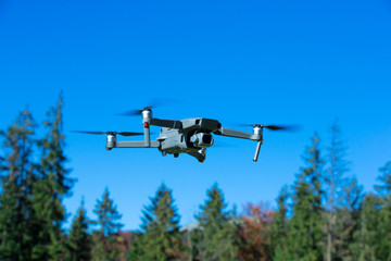 The drone copter flying with digital camera.