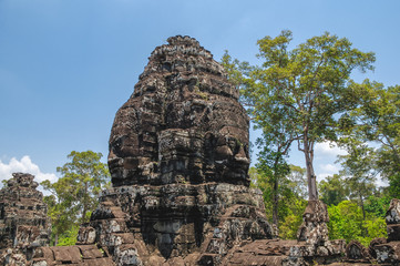Anciente stone heads in Bayon temple in Angkor Wat, Cambodia.