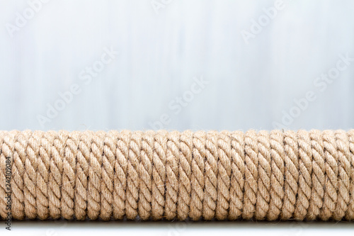 Sisal rope cat scratcher on white background  Copy space for