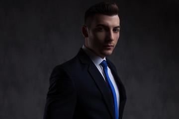 portrait of attractive businessman wearing blue tie standing