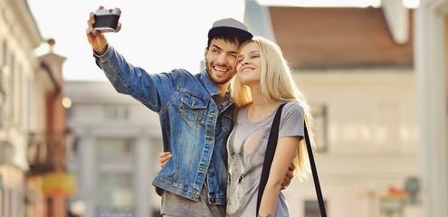 Beautiful young couple making selfie photo